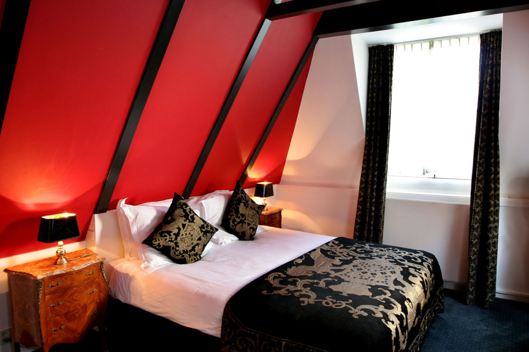 Deluxe red room on the top floor of the Ambassade Hotel