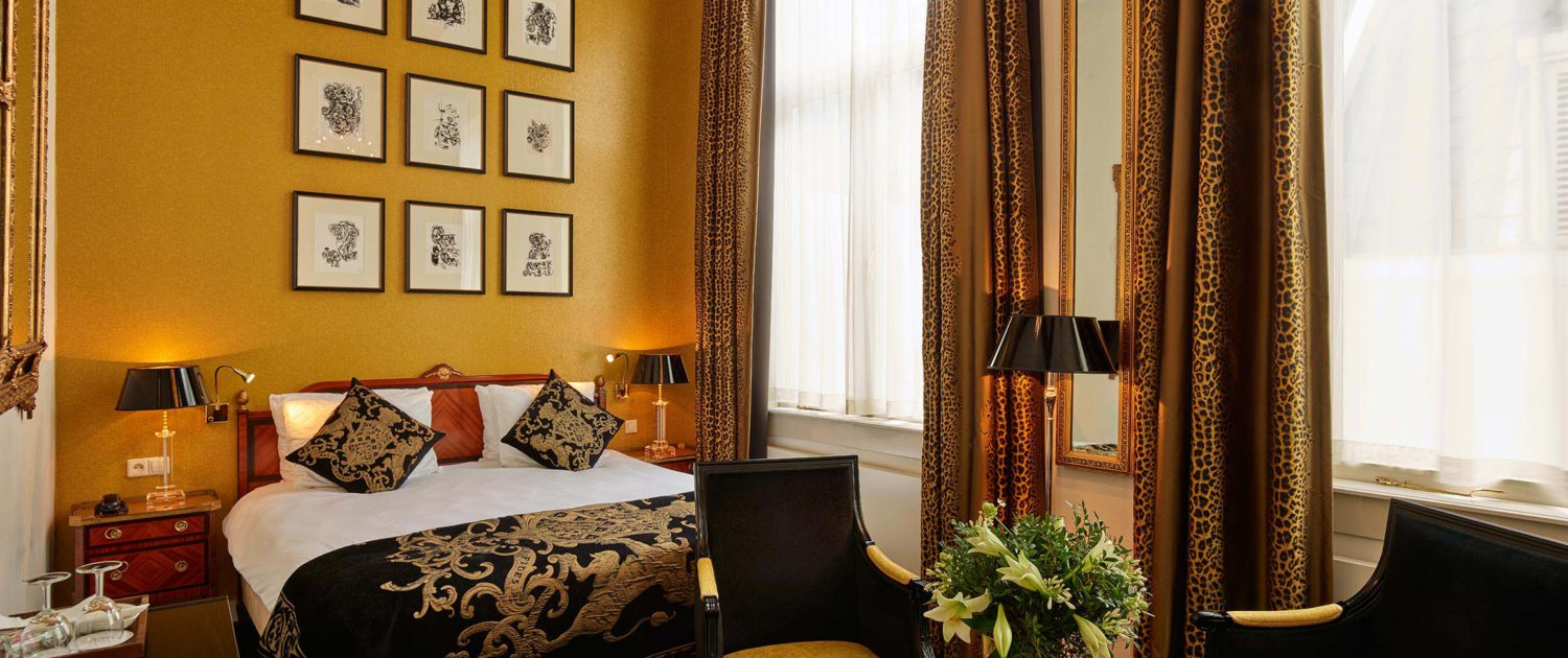 Our classic room with a golden and black theme and a courtyard view